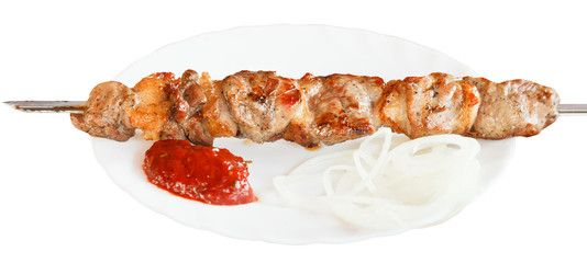 one lamb shish kebab on white plate isolated