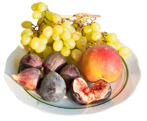 Crimean autumn seasonal fruits on plate isolated
