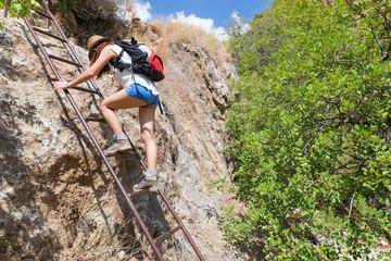 Woman climbing ladder.