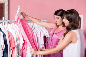 women shopping in a clothing store