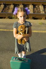 Retro portrait of a little girl at railway platform