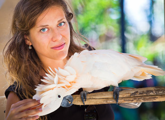 Woman in zoo with parrot