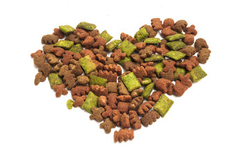Dried food for dog/puppy, with a shape of heart isolated