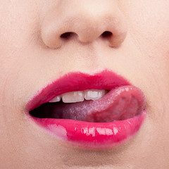 Woman wearing red lipstick and licking her lip