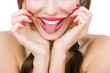 Beautiful smiling girl with retainer for teeth sticking her tong