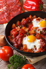 Fried eggs with chorizo and vegetables on the Flemish recipe