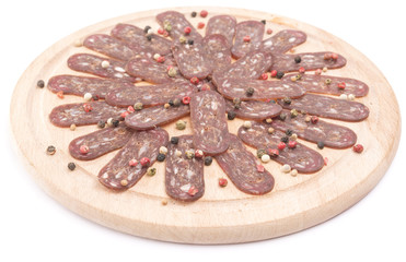 flat sausage on rounder wooden board isolated