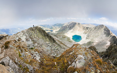 Man standing mountain peak panorama.