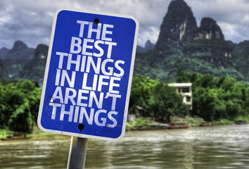The Best Things In The Life Aren't Things sign