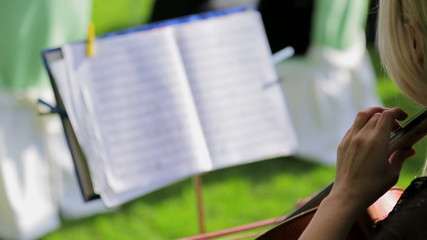 Woman is Playing Violon