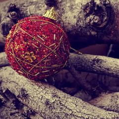 christmas ball on a pile of logs