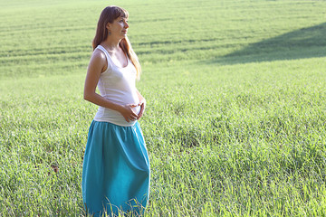pregnant woman in a summer field