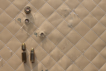 hit shot 9mm in Kevlar bulletproof vest