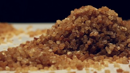 Brown sugar from sugar cane,rotating