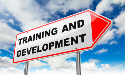 Training and Development on Red Road Sign.