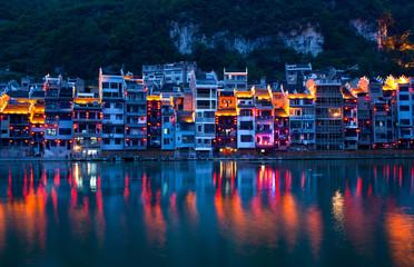 Zhenyuan Ancient Town on Wuyang river at twilight, China