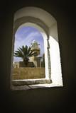Nebi Musa mosque muadzin tower through window.. poster