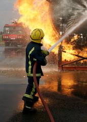fire fighter fighting blaze