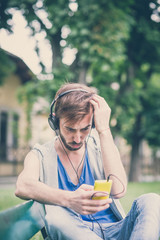 young hipster gay man listening music headphones