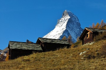 Traditional hutts with stone roof and Matterhorn