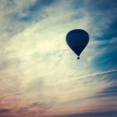 silhouette of hot air balloon at sunset
