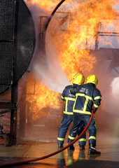 fire fighter at large chemical fire