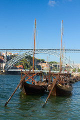 two rabelo boats and bridge of Dom Luis , Portugal