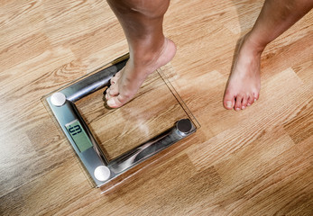 The woman weighed on the scales.