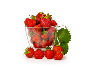 Fresh strawberries in a glass mug isolated on white background