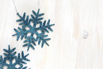 Snowflakes on white  wooden background