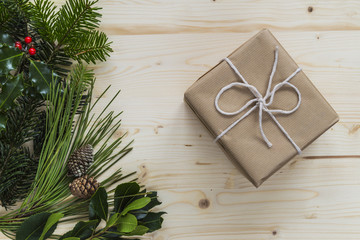 Christmas present with festive foliage