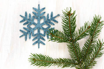 Snowflake on white  wooden background