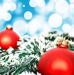 Red christmas ornament ball against blue bokeh background