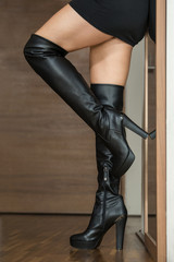 Woman in black over knee boots