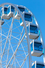 Ferris wheel over clear blue sky