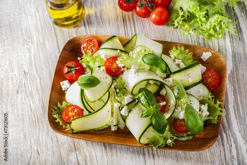 Fototapeta Zucchini salad with tomatoes and cheese