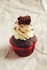 Black forest chocolate cupake with whipped cream frosting