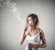 Tattoed girl smoking a cigarette