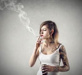 Tattoed girl smoking a cigarette