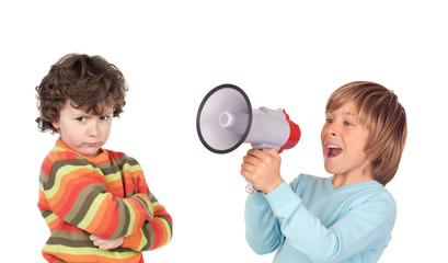 Funny angry child because of megaphone