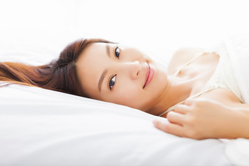 beautiful young  asian woman sleeping in the bed