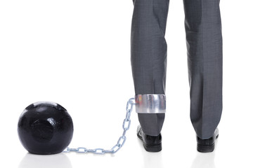 Businessman With Ball And Chain Attached To Leg