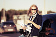 Fashion business woman with financial papers at the car