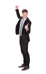 Smiling Young Businessman Gesturing Thumbs Up