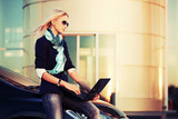 Fototapety Young fashion business woman with laptop on the car parking