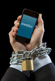 man wrists chain locked to mobile phone in smartphone addiction poster