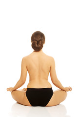 Woman in underwear practicing yoga