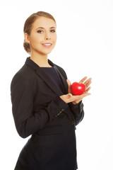 Businesswoman holding heart