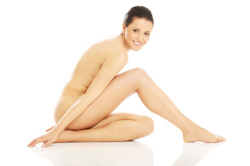Nude woman sitting on the floor