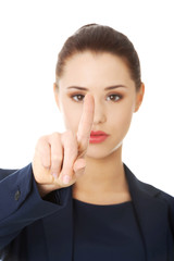 Businesswoman pointing by a finger